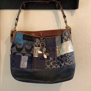 Coach denim and leather purse.